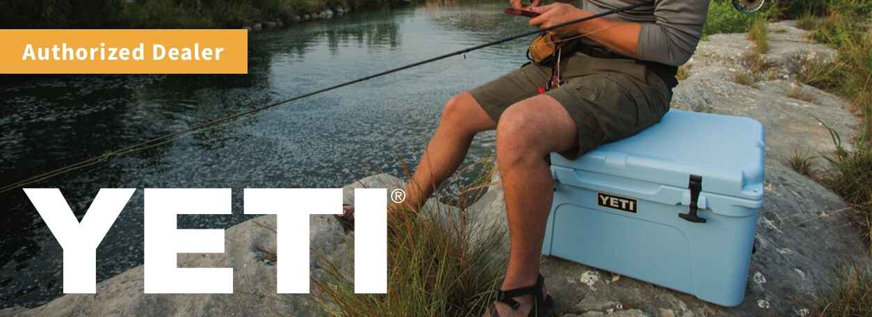 Man carrying YETI cooler - Authorized Dealer